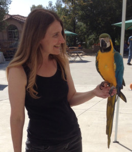 Sindi and a Blue and Gold Macaw parrot