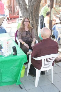 Sindi doing a psychic reading and animal communication session at a public event at the Friends of Cats sanctuary and rescue.